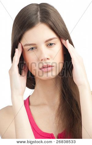 Portrait of pretty young woman having a headache, against white background