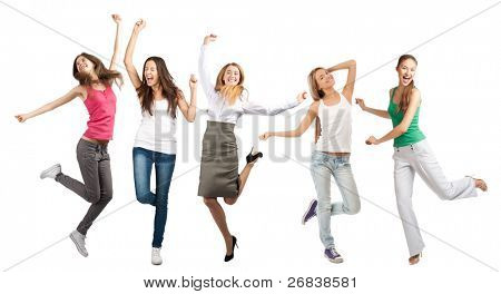Group of cheerful young women holding hands up and dancing. Isolated on white background