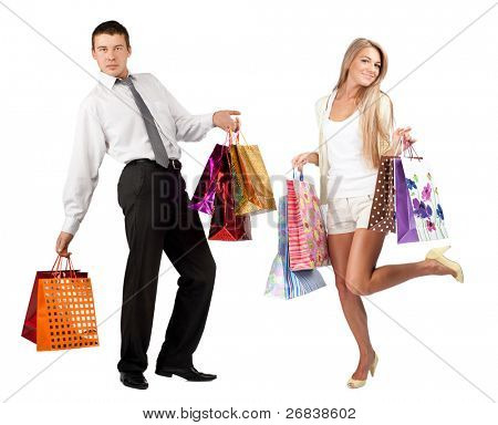Happy young woman and handsome man with colorful shopping bags. Isolated on white background