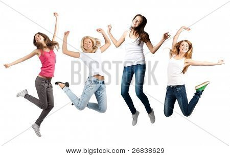 Group of cheerful young women jumping in air. Isolated on white background