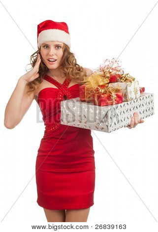 Excited Christmas shopping woman santa hat holding many Christmas gifts in her hands