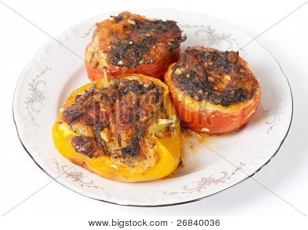 Tasty stuffed vegetables in porcelain plate isolated in white