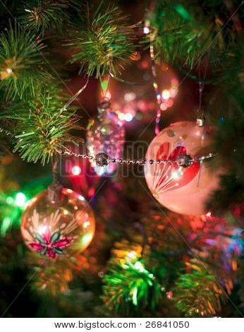 Christmas tree decorated with very old vintage toys, closeup, long exposure, light painting, tripod