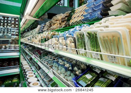 Shelf with groceries in supermarket, tm's removed