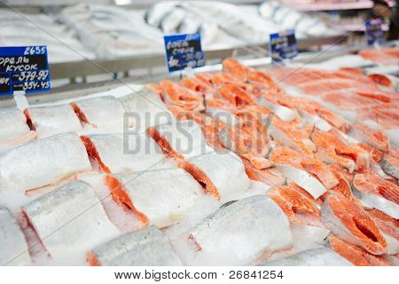Salmon steaks on cooled market display, TM's removed from the tags