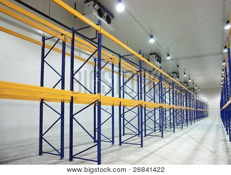 Large newly build warehouse with steel shelves