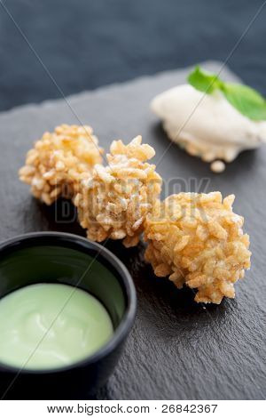 Popular asian street food goreng pisang (fried bananas in crispy rice) served in modern way with ice-cream and pandan sauce
