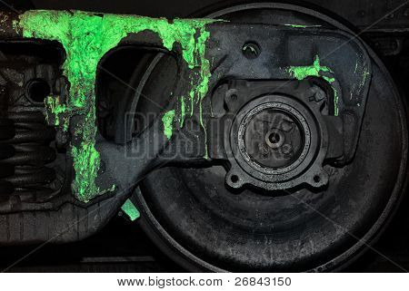 Black wheel of a train polluted by a paint of toxic colour