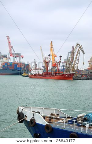 View on trading port with an unloading vessel