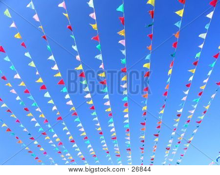 Colored Flags On Blue Sky
