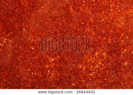 Closeup of red glaze background with bubbles