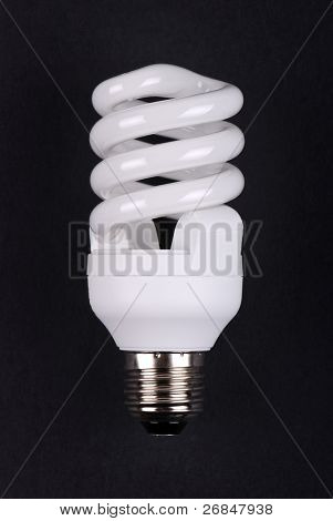 energy saving bulb on black background