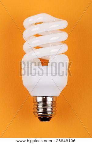 energy saving bulb on yellow background
