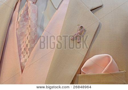 Pink ribbon pin on tuxedo
