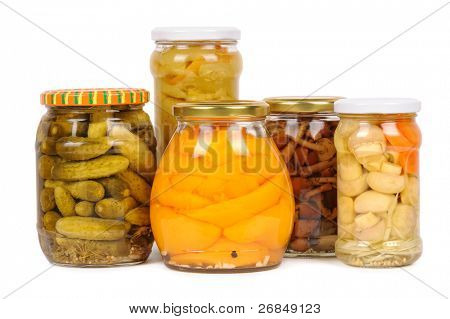 a set of canned vegetables. cucumbers, peppers, mushrooms and carrots. isolated
