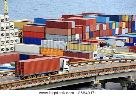 truck transports container to a warehouse near the sea