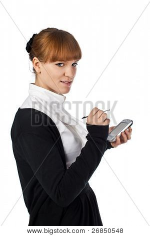 Young businesswoman using mobile organiser isolated on white background