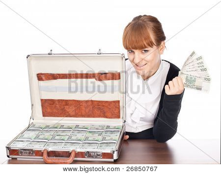 Brown briefcase full of hundred zloty money isolated on white