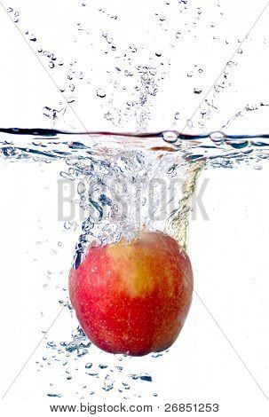 red apple splashing into water isolated on white background