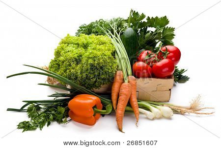 Juicy vegetables in punnet on white background