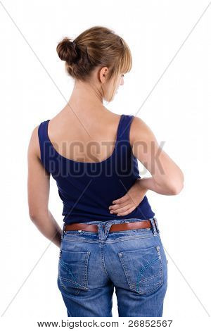 Female in blue shirt and jeans holding lower back in pain