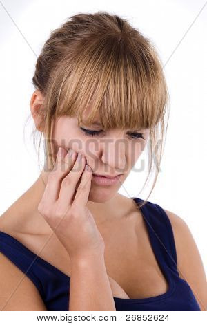 Close-up of a beautiful brunette woman with a toothache. Isolated on white background.