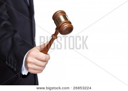 Gavel in hand on white with copy space