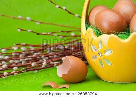 Basket full of Easter eggs and flower