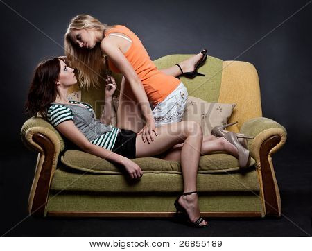 Seductive young women on sofa