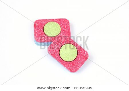 Two colorful isolated dishwasher tablets