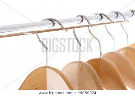 coat hangers on a clothes rail, close up
