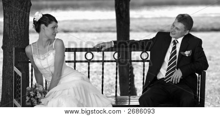 Newlywed Couple On Park Bench