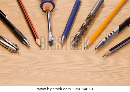 tools and pens at wood table