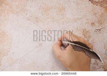 Schreiben von männlichen Hand mit Feder