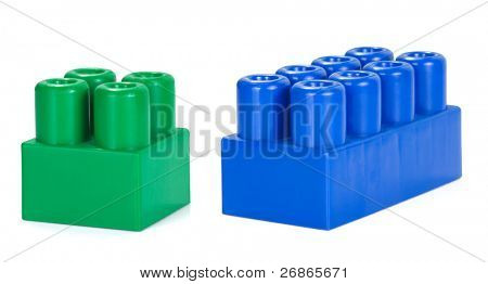two plactic colorful bricks on white