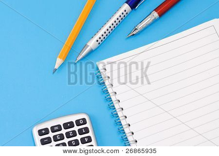 ink pen, pencil and calculator with binder pad