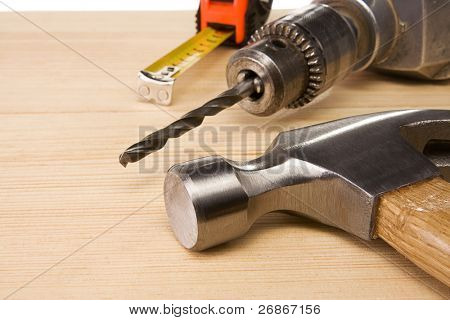 hammer and tape measure on wood brick