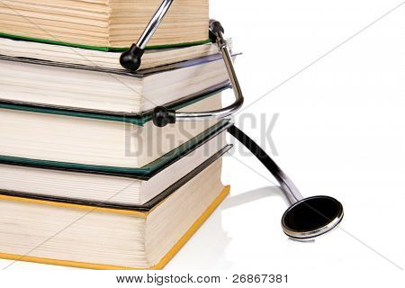 pile of several books and black stethoscope isolated on white background