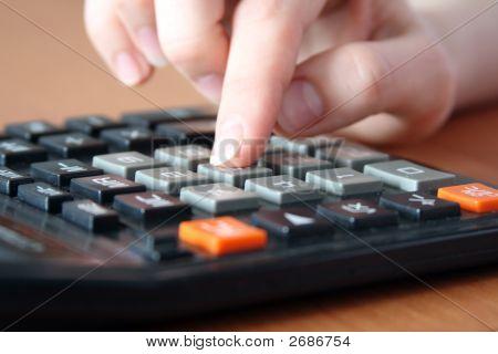 Hand On The Calculator