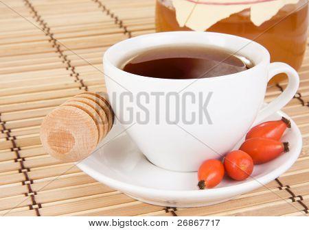 berry dog tea and honey on wood