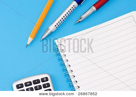 pen, pencil and calculator with notebook