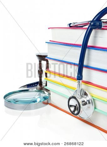 pile of books, pen and stethoscope isolated on white background