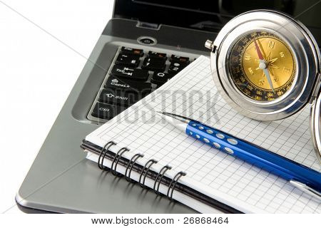 notebook laptop, compass and blue pen isolated on white background