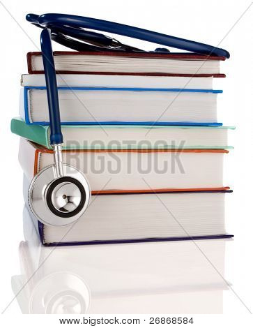 pile of books and stethoscope isolated on white background