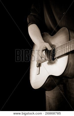 guitar and man on isolated on black background