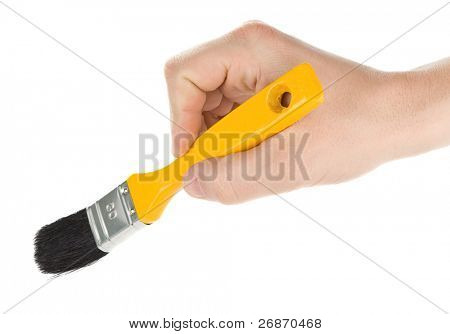 male hand and yellow brush isolated on white background