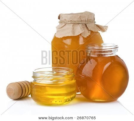 glass jar and pot of honey with stick isolated on white background