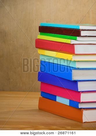 pile of new books on wood texture