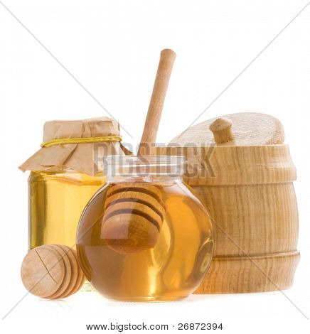 glass pot of honey and stick isolated on white background