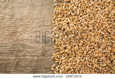 wheat grain on wood texture background